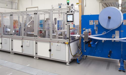 Face mask production machine featured